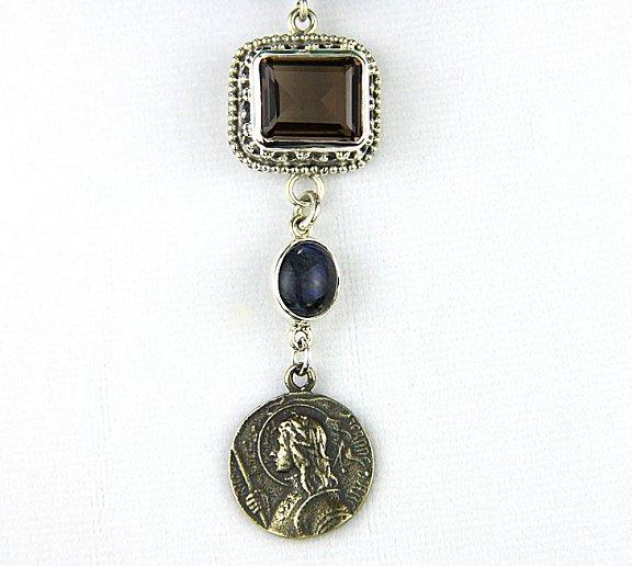 reve closeup coin and iolite